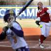 OU pitcher Keilani Ricketts fires a pitch past LSU's Cassie Trosclair on her way to a three hit shutout during the University of Oklahoma - Louisiana State University game at