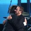 Paul McCartney, left, embraces Ringo Starr on stage at the 56th annual Grammy Awards at Staples Center on Sunday, Jan. 26, 2014, in Los Angeles. (Photo by Matt Sayles/Invision/AP)