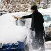 Dillon Dylan brushes snow from his automobile in Denver on Wednesday, Nov. 2, 2011.    A fast-moving snowstorm is causing blizzard conditions in parts of eastern Colorado. The National Weather Service says gusts up to 40 mph will cause blowing and drifting snow until around noon Wednesday. The mountains west of Denver have also received heavy snow.   .(AP Photo/Ed Andrieski) ORG XMIT: COEA101