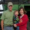 This September 2012 photo provided by the Iowa Farm Bureau shows farmer Randy Dreher, his wife, Crystal, and their 2-year-old daughter, Kaytlin, north of Audubon, Iowa. Dreher says he and his wife have saved more in recent years, but being prudent and conservative has its limits.