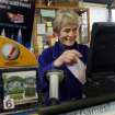 Canterbury Country Store manager Toni Halla smiles as she rings in another powerball customer, Wednesday, Nov. 28, 2012 in Canterbury, N.H. Halla says sales in the small town of 12,000 people has been brisk. (AP Photo/Jim Cole)