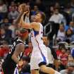 Los Angeles Clippers forward Blake Griffin, right, puts up a shot as Sacramento Kings center DeMarcus Cousins defends in the first half of an NBA basketball game in Los Angeles on Saturday, Dec. 1, 2012. (AP Photo/Richard Hartog)