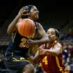 Iowa guard Theairra Taylor (23) has the ball knocked away by Iowa State guard Nikki Moody (4) as she drives to the hoop during the first half an NCAA college basketball game Thursday, Dec. 6, 2012 at Carver-Hawkeye Arena in Iowa City, Iowa.  (AP Photo/The Gazette,Brian Ray)
