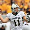 Baylor quarterback Nick Florence (11) throws during their NCAA college football game against West Virginia in Morgantown, W.Va., Saturday, Sept. 29, 2012. (AP Photo/Christopher Jackson)
