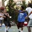 This film publicity image released by Doin' It In The Park, LLC shows female basketball player Niki Avery, second left, playing basketball in the Spanish Harlem section of New York during filming of the documentary