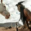This publicity image released by Disney shows Johnny Depp as Tonto, right, and Armie Hammer as The Lone Ranger, in a scene from