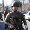 Heavily armed Connecticut State troopers are on the scene at the Sandy Hook School where authorities say a gunman opened fire, leaving 27 people dead, including 20 children, Friday, Dec. 14, 2012. (AP Photo/The Journal News, Frank Becerra Jr.) MANDATORY CREDIT, NYC OUT, NO SALES, TV OUT, NEWSDAY OUT; MAGS OUT ORG XMIT: NYWHI119