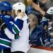 Vancouver Canucks' Kevin Bieksa, left, drops his gloves as he and San Jose Sharks' Andrew Desjardins fight during third period NHL hockey action in Vancouver, British Columbia, on Thursday Nov. 14, 2013. (AP Photo/The Canadian Press, Darryl Dyck)