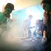FILE - In this April 20, 2013 file photo, Nick Villejo of Refine collective and Jared Smith smoke vaporized marijuana during