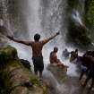 Voodoo pilgrims bathe in a waterfall believed to have purifying powers during an annual pilgrimage in Saut d' Eau, Haiti, Saturday July 16, 2011. The annual pilgrimage to Saut d' Eau venerates the site where believers say the Virgin Mary, whom many here revere as the goddess of love, Ezili Danto, once appeared.  (AP Photo/Eduardo Verdugo)
