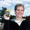Anne Harris uses her GPS navigator to participate in the Geocaching craze sweeping the nation. She will conduct workshops on Geocaching for the Pioneer Library System  Community Photo By:  Gary Kramer  Submitted By:  Gary, Norman