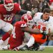 Oklahoma State quarterback Zac Robinson (11) has his helmet knocked off by Oklahoma's Jeremey Beal (44) during the first half of the Bedlam college football game between the University of Oklahoma Sooners (OU) and the Oklahoma State University Cowboys (OSU) at the Gaylord Family -- Oklahoma Memorial Stadium on Saturday, Nov. 24, 2007, in Norman, Okla.   Photo by Chris Landsberger, The Oklahoman