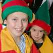 Cousins Nick and Madie Noble, ages 10 and 8, volunteer as Santa's helpers during the Oklahoma Municipal Contractor's Association annual Christmas party for the inpatients of the J. D. McCarty Center for children with developmental disabilities in Norman. Nick is the son of Tom and Gabi Noble. Madie is the daughter of Donny and Cheryl Noble. Between the two families there are six children who volunteer as Santa's helpers.  Community Photo By:  Greg Gaston  Submitted By:  Greg, Norman
