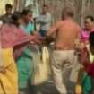 In this image taken from video obtained from Network 1 News and Information Syndicate (NNIS), which has been authenticated based on its contents and other AP reporting, Bikram Singh Brahma, center, a leader of India's ruling Congress party, has his shirt torn off by women in the village of Santipur, India, on Thursday, Jan. 3, 2013. Police said Brahma was visiting the village of Santipur on the Bhutan border when he entered a woman's house and raped her at 2 a.m. In a sign that attitudes might be changing since the rape of a 23-year-old woman in New Delhi, who died of severe internal injuries over the weekend, police have arrested Brahma. (AP Photo/NNIS)