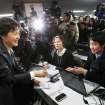 South Korea's president-elected Park Geun-hye, left, greets reporters after a press conference at the headquarters of Saenuri Party in Seoul, South Korea, Thursday, Dec. 20, 2012. Park was elected South Korean president Wednesday, becoming the country's first female leader despite the incumbent's unpopularity and her own past as the daughter of a divisive dictator. (AP Photo/Ahn Young-joon)