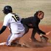 University of Iowa's Liz Watkins slides safely into second with a double as Oklahoma State Cowgirl Chelsea Garcia fields the throw during the Oklahoma State - Iowa game at