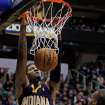Indiana Pacers guard Paul George (24) dunks the ball in the first half during an NBA basketball game against the Utah Jazz, Saturday, Jan. 26, 2013, in Salt Lake City. (AP Photo/Steve C. Wilson)
