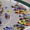 Cars sit on pit road before the start of a NASCAR Sprint Cup Series auto race at Martinsville Speedway, Sunday, March 30, 2014, in Martinsville, Va (AP Photo/Steve Shappard)