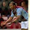 Aston Villa's Gabby Agbonlahor celebrates his goal during their English Premier League soccer match against Sunderland at the Stadium of Light, Sunderland, England, Wednesday, Jan. 1, 2014. (AP Photo/Scott Heppell)