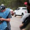 Ray Miller, left, hugs his wife Cindy before he heads into the burn zone with a police escort Friday, June 14, 2013 to try to retrieve medication from their home that was burned to the ground in the Black Forest fire near Colorado Springs, Colo.  Little more than 36 hours after it started in the Black Forest area northeast of Colorado Springs, the blaze surpassed last June's Waldo Canyon fire as the most destructive in state history. That blaze burned 347 homes and killed two people.  Bradley thinks her home escaped the fire.  (AP Photo/The Gazette, Michael Ciaglo)