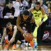 Oklahoma State forward Le'Bryan Nash (2) picks up a loose ball while heading up court past Baylor center Isaiah Austin (21), right, in the first half of an NCAA college basketball game, Monday, Feb. 17, 2014, in Waco, Texas. (AP Photo/Waco Tribune Herald, Rod Aydelotte)