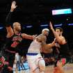 New York Knicks' J.R. Smith attempts to drive to the basket between Chicago Bulls' Taj Gibson, left, and Marco Belinelli, right, of Italy, during the first half of an NBA basketball game Friday, Jan. 11, 2013, at Madison Square Garden in New York. (AP Photo/Bill Kostroun)