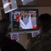 In this photo provided by International Security Assistance Force Regional Command (South), service members watch the Royal Wedding of Prince William and Kate Middleton, Friday, April 29, 2011, while taking a break at a coffee house on Kandahar Airfield in Kandahar, Afghanistan. (AP Photo/US Navy - Ensign Haraz N. Ghanbari)  ORG XMIT: AFGH107