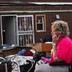Janee Keiser, 66 of Carney, talks to her son on the phone while sitting outside of her house that was destroyed when a tornado went through Carney, Okla. on May 19, 2013.  KT King/For the Oklahoman