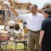 President Barack Obama tours the Plaza Towers addition in Moore, Okla., beside Moore Mayor Glenn Lewis on Sunday, May 25, 2013. Photo by Bryan Terry The Oklahoman