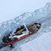 In this Dec. 26, 2013 photo provided by the U.S. Coast Guard the icebreaker Mackinaw maintains a shipping lane on the St. Marys River linking Lakes Superior and Huron. It's been so bitterly cold for so long in the Upper Midwest that the Great Lakes are almost completely covered with ice. The last time they came this close was in 1994, when 94 percent of the lakes' surface was frozen. (AP Photo/U.S. Coast Guard