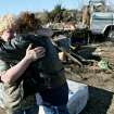 TORNADO / STORM / DAMAGE / HOUSE: Margie Hughes (left) gets a hug from her sister Neda Wilson as they look at Margie's destroyed home following deadly storms around Lone Grove, Okla., Feb. 11, 2009. By John Clanton, The Oklahoman ORG XMIT: KOD