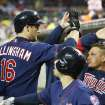Minnesota Twins' Josh Willingham (16) is congratulated in the dugout after his three-run home run off Detroit Tigers starting pitcher Rick Porcello during the third inning of a baseball game in Detroit, Thursday, May 23, 2013. (AP Photo/Carlos Osorio)
