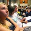 Melanie Nicholls, a sophomore at Augustana College from Rockford, Ill., watches the first presidential debate between President Obama and Gov. Mitt Romney, in a packed Great Hall of Emmy Carlsson, in Evald Hall on campus, Wednesday, Oct. 3, 2012 in Rock Island, Ill. (AP Photo/The Quad City Times, John Schultz)