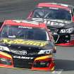 Clint Bowyer leads Kasey Kahne during practice for Sunday's NASCAR Sprint Cup series auto race at New Hampshire Motor Speedway, Saturday, Sept. 21, 2013, in Loudon, N.H. (AP Photo/Jim Cole)