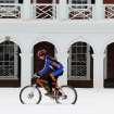A cyclist rides on the lawn area at the   at the University of Virginia Thursday Feb. 13, 2014 after a snowfall in Charlottesville, VA. (AP Photo/Daily Progress, Andrew Shurtleff)