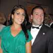 In this May 16, 2011 photo Dr. Scott Kelley, right, and his wife Jill Kelley pose for a photo in Tampa, Fla. Jill Kelley's attempt to climb the Tampa social ladder _ the rungs of which included some high-ranking military officials _ has come to an ignominious halt. Accounts of lavish parties at her bayfront mansion have been replaced by reports of her family's financial woes and other dirty laundry, and claims that she traded on her acquaintance with David Petraeus to try to further lucrative business dealings. Now, even her
