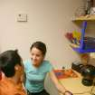 Alicia Oldham, a doctoral student in occupational therapy from Creighton University, is working with J. D. McCarty Center patient Julio Regalado, Jr. on switch activation to learn cause and affect awareness. From this training Regalado will eventually learn to turn on and off things like a television, radio or augmentative communications device. Regalado was one of the patients Oldham worked with during her 12-week pediatric clinical rotation at the J. D. McCarty Center in Norman, Oklahoma. The McCarty Center is a pediatric rehab hospital specializing in the care and treatment of children with developmental disabilities.  Community Photo By:  Greg Gaston  Submitted By:  Greg,
