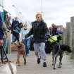 Passengers and their pets depart one of the last ferries from the Fire Island communities in preparation for the arrival of Hurricane Sandy, Sunday, Oct., 28, 2012, in Bay Shore, N.Y. (AP Photo/Kathy Kmonicek)