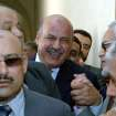 FILE - In this Thursday, May 18, 2006 file photo, then a pro-reform Egyptian judge Mahmoud Mekki, center, enters a disciplinary hearing in Cairo at the Egyptian Supreme Court. Egypt's state TV says Vice President Mahmoud Mekki has resigned. Mekki's Saturday, Dec. 22, 2012 resignation was announced with more than five hours to go of voting in the second and final phase of a referendum on a disputed, Islamist-backed constitution. (AP Photo, File)