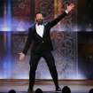 Host Hugh Jackman performs on stage at the 68th annual Tony Awards at Radio City Music Hall on Sunday, June 8, 2014, in New York. (Photo by Evan Agostini/Invision/AP)
