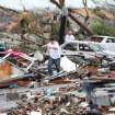 People walk through debris around the Cedar Crest neighborhood near 15th Steet in Tuscaloosa, Ala., Wednesday, April 27, 2011. A strong tornado moved through the city of Tuscaloosa Wednesday afternoon. (AP Photo/The Tuscaloosa News, Dusty Compton)