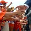 Clemson fans reach out to the Tiger players during the Tiger Walk before the start of an NCAA college football game against Georgia Tech Saturday, Oct. 6, 2012 at Memorial Stadium in Clemson S.C.(AP Photo/ Richard Shiro)