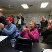 John Dockendorff, from left, Roxy and John Riessen, along with others react to projections that President Obama won the election, during an election night watch party, Tuesday Nov. 6, 2012 at the Des Moines County Democratic Headquarters in Burlington, Iowa. (AP Photo/The Hawk Eye, John Lovretta)