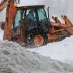 A Midwest City street department backhoe  works to clear snow from Air Depot near Interstate 40.   A winter storm created whiteout conditions and caused snow drifts that made problems for the few motorists who ventured out Tuesday morning, Feb. 1, 2011. Photo by Jim Beckel, The Oklahoman