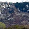 Hundreds of trees are knocked down where a massive mudslide happened near Collbran, Colo., Monday, May 26, 2014. Rescue teams are searching for three men missing after a half-mile stretch of a ridge saturated with rain collapsed. (AP Photo/Grand Junction Daily Sentinel, Dean Humphrey)