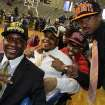 Skyline football players Ellis Onic (Northern Colorado), Kelvin Coleman (Texas A&M-Commerce), Kerrick Huggins (Oklahoma), Devante Kincade (Mississippi) and Ra'Shaad Samples (Oklahoma State) wear their new school colors during the  Dallas ISD signing day ceremony at Ellis Davis Field House in Dallas on Wednesday, February 36 2013. (Louis DeLuca/The Dallas Morning News)
