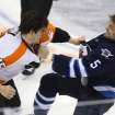 Philadelphia Flyers' Tye McGinn (15) fights with Winnipeg Jets' Mark Stuart (5)  during the second period of an NHL hockey game in Winnipeg, Manitoba, Tuesday, Feb. 12, 2013. (AP Photo/The Canadian Press, Trevor Hagan)