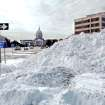 Large piles of snow remain after trucks cleared snow from the parking lots of state office buildings north of the state Capitol Thursday, Feb. 3, 2011. Photo by Jim Beckel, The Oklahoman