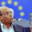 Moncef Marzouki, President of Tunisia, shows his