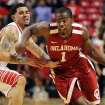 Oklahoma's Sam Grooms (1) drives past Texas Tech's Josh Gray during their NCAA college basketball game in Lubbock, Texas, Wednesday, Feb. 20, 2013. (AP Photo/The Avalanche-Journal, Stephen Spillman) ALL LOCAL TV OUT ORG XMIT: TXLUB107